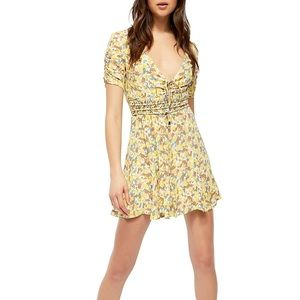 Free people. NWT Forget me not floral minidress